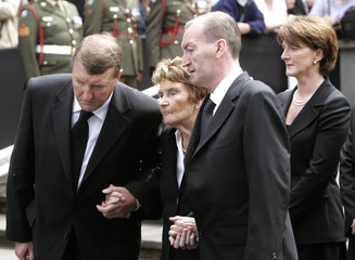Charles Haughey's family follow his coffin as it is carried from the Church of Our Lady of Consolation, Donnycarney in Dublin