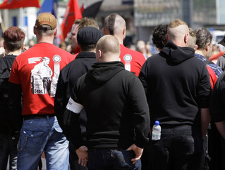 German far-right National Democratic Party (NPD) members and supporters take part in a demonstration in Nuremberg