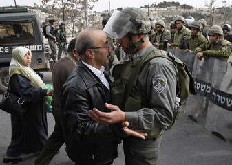 Palestinian man argues with Israeli border police outside Jerusalem's Old City