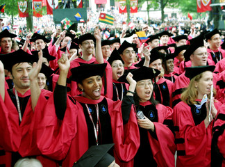 HARVARD GRADUATE STUDENTS CHEER AS THEY ARE AWARDED THEIR DEGREES.