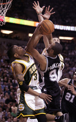 San Antonio Spurs Tony Parker attempts shot over Seattle SuperSonics Antonio Daniels and Nick Collison ...