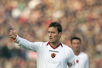 AS Roma's Totti gestures during his Italian Serie A soccer match against Livorno at the Armando Picchi stadium in Livorno