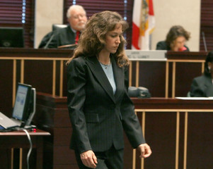 Former astronaut Lisa Nowak leaves the stand after testifying at a pre-trial hearing in Orange County Court in Orlando