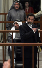 Former Iraqi President Saddam argues with chief judge Rahman in Baghdad