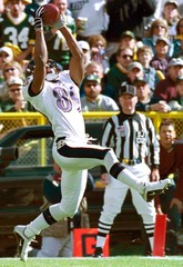 RAVENS RECEIVER TAYLOR CATCHES TOUCHDOWN PASS AGAINST PACKERS IN GRRENBAY.