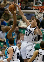 Jazz Kirilenko blocks shot of West (L) of Hornets during NBA game in Utah