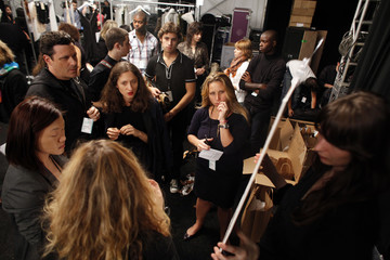 Designer Isaac Mizrahi works with his crew before his Spring 2010 collection show during New York Fashion Week