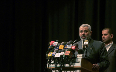 Palestinian PM Haniyeh speaks to the people during a rally in Gaza