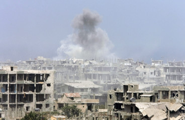 Smoke from artillery and tank shelling rises from the Palestinian Nahr al-Bared refugee camp in northern Lebanon