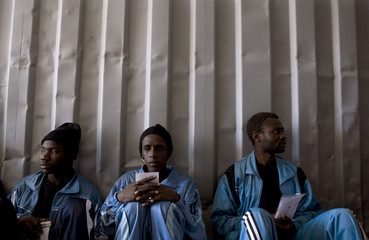 Would-be immigrants rest in a Red Cross container at the port of Gran Tarajal in Spain's Canary island of Fuerteventura