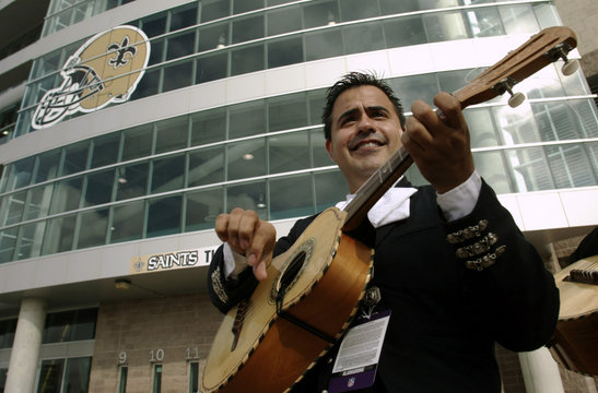 Mariachi plays guitar outside Alamodome before Saints and Bills NFL game