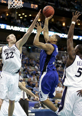 Creighton guard Porter is rejected by Nevada forward Fazekas in the first half of their NCAA First Round South Regional basketball game in New Orleans