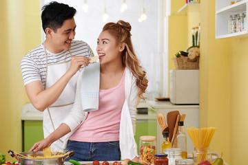 Feeding girlfriend with potato chip
