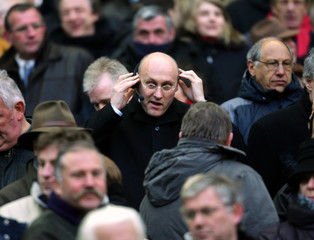 French National rugby team coach Laporte adjusts microphone during Six Nations rugby union match against England near Paris