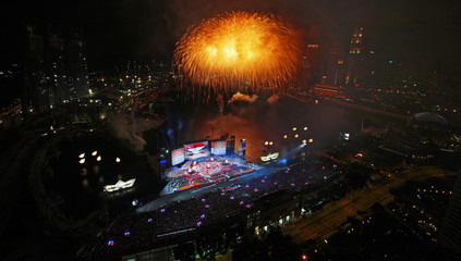 Fireworks explode over the Marina Bay floating platform during Singapore's 44th National Day celebrations