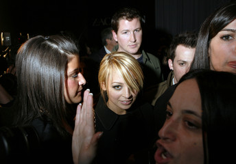 Nicole Richie works her way through the crowd at the Zac Posen 2007 fall collection show during New York Fashion Week