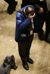 Trader reacts on floor of New York Stock Exchange near close in trading session