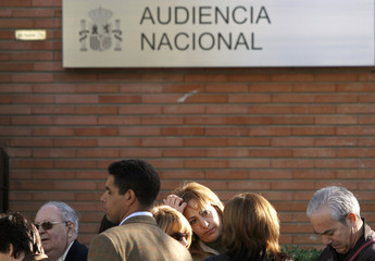 Relatives of victims and general public enter an annex of the high court in Madrid