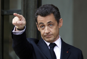 France's President Nicolas Sarkozy gestures after a ceremony in Paris