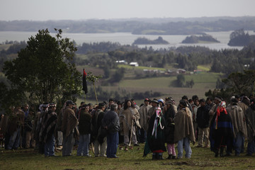"""Members of the local Mapuche Indian communities gather during a """"Xrawen"""" ( meeting) at Puerto Dominguez town near Temuco city"""