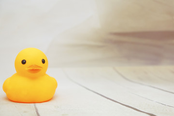 yellow duck toys over wooden table backgrounds