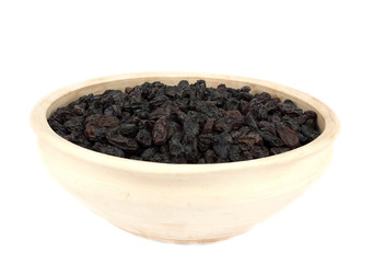 Raisins in bowl isolated over white background