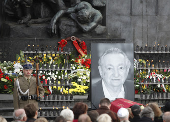 A picture of Marek Edelman is placed at the Monument of the Ghetto Uprising during his funeral in Warsaw