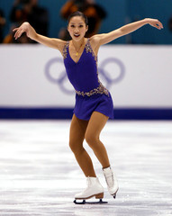 KWAN OF USA SKATES SHORT PROGRAM IN WOMENS OLYMPIC FIGURE SKATING.