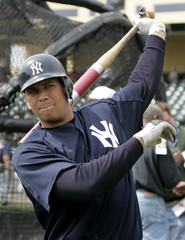 Alex Rodriguez warms up before game with Braves.