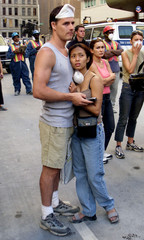 ONLOOKERS EMBRACE NEAR SITE OF WORLD TRADE CENTER DISASTER.