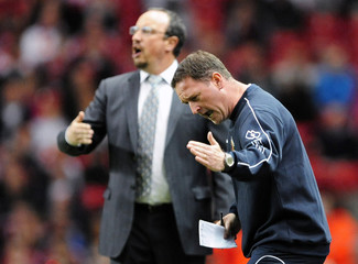 Crewe Alexander coach Steve Holland gestures beside Liverpool coach Rafael Benitez during their English League Cup soccer match at Anfield in Liverpool