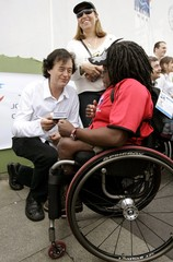 Former Led Zeppelin guitarist Page signs an autograph for Sally Tomas during the peace ceremony in ...