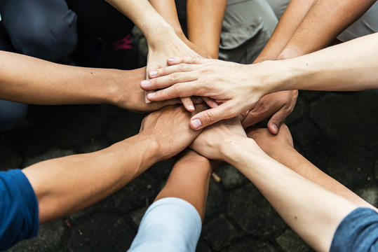 Group of people United Hands to built teamwork together with Spirit - teamwork concepts.