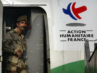 A JORDANIAN SOLDIER GUARDS A FRENCH CHARTER PLANE LOADED WITHHUMANITRIAN AND MEDICAL AID.