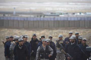 Members of the Afghan border police force take part in military training at the border police headquarters near Herat