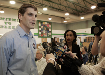 Josh, son of Republican presidential candidate Romney, speaks to reporters in Nevada