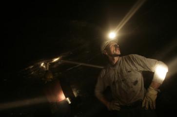 "A Bosnian miner pauses from work deep inside coal mine ""Sretno"" near the central Bosnian town of Breza"