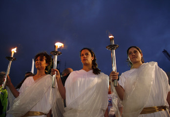 Israeli activists hold torchs during the lighting ceremony in Tel Aviv