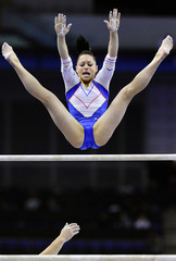 Tamirjan of Romania competes on the uneven bars in the qualification round of the Gymnastics World Championships in London