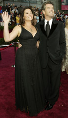 ACTOR PIERCE BROSNAN AND HIS WIFE KEELY SHAYE SMITH ARRIVE FOR THE OSCARS IN HOLLYWOOD.