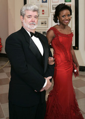 Director George Lucas and Mellody Hobson arrive at the White House for the Kennedy Center Honors in Washington