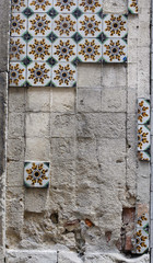 A wall robbed of most of its decorative tiles is seen in Lisbon's town