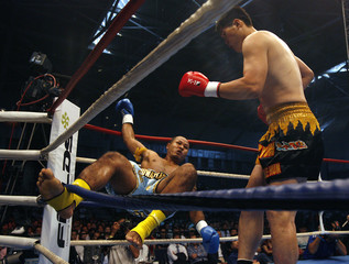Nor-seepun of Thailand falls during his fight against Kim of South Korea during their K-1 World GP match at the Nangang Exhibition Hall in Taipei