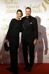 Former German swimming star van Almsick and her husband Harder pose for photographers on the red carpet for the Gala of Sport in Wiesbaden