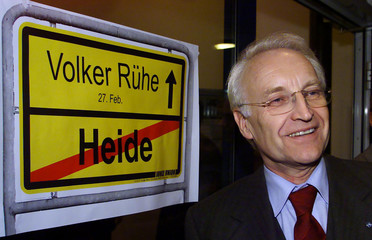 EDMUND STOIBER OF BAVARIA POSES IN FRONT OF A BANNER IN MOELLN.