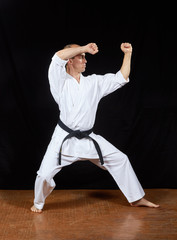 Athlete is training the techniques of karate