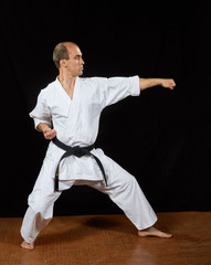 In the karate stand, the athlete performs a strike