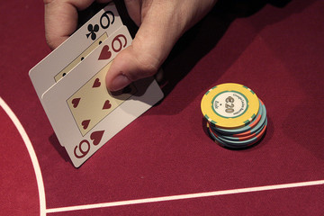 A gambler plays a hand of poker at the new Casino Barriere in Toulouse