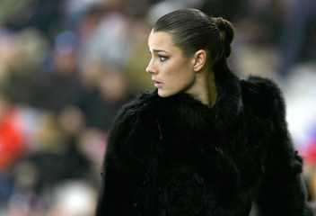 Czech Republic model Seredova watches the Czech Republic play Italy in a men's ice hockey game in Turin