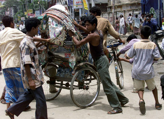 Bangladeshi opposition activists attack a rickshaw to enforce a strike in Dhaka August 8, 2000. The ..